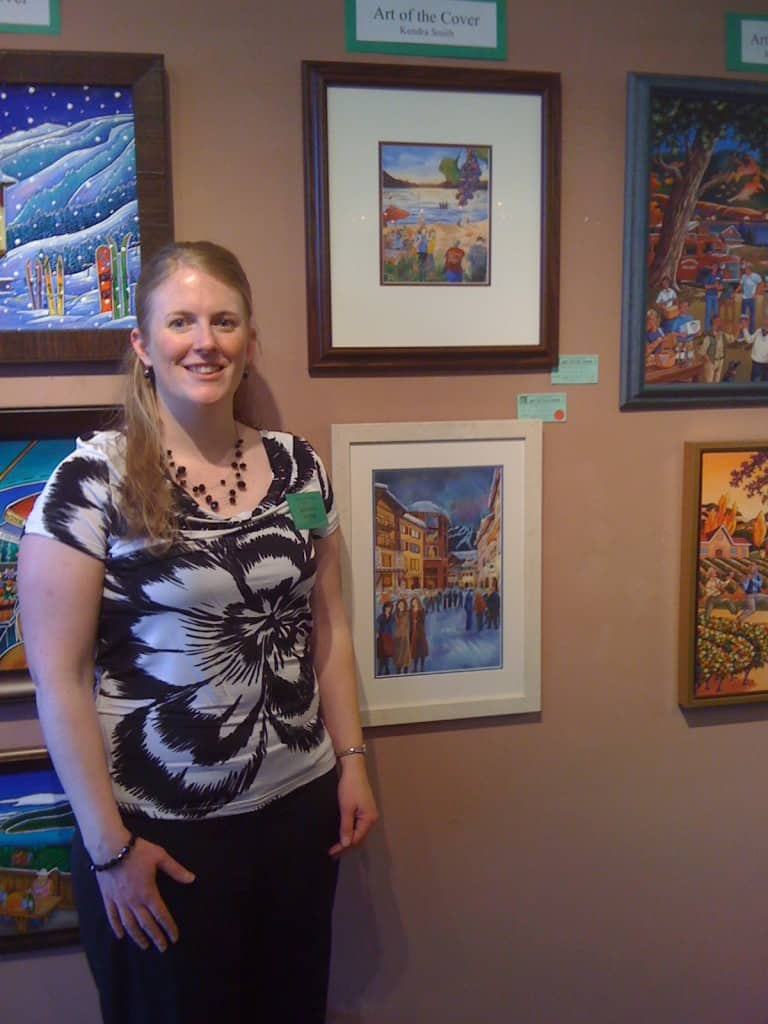 Kendra Smith with her paintings at Art of the Cover