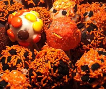 Cake Pops with Black and Orange Sprinkles and Reeces Pieces